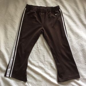 Nike brown and white striped capris pants